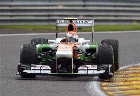 Force India Formula One driver Adrian Sutil of Germany takes a curve during the first practice session of the Belgian F1 Grand Prix at the Circuit of Spa-Francorchamps August 23, 2013. REUTERS/Laurent