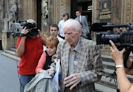 Laszlo Csatary leaves the Budapest court building. Hungarian authorities detained, grilled and put under house arrest on Wednesday the 97-year-old who tops the Simon Wiesenthal Center's dwindling wanted-list of suspected Nazi war criminals