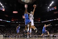 San Antonio Spurs' Manu Ginobili (R) goes up for a layup during the game against Oklahoma City Thunder on May 29. Oklahoma City will host games three and four against the Spurs on Thursday and Saturday