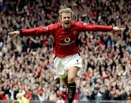 David Beckham celebrates after making it Manchester United 1-Charlton 0 during a Premiership clash at Old Trafford in 2003. Manchester United, overloaded with debt since their takeover by a billionaire American family of investors, is moving to raise cash through a US share sale