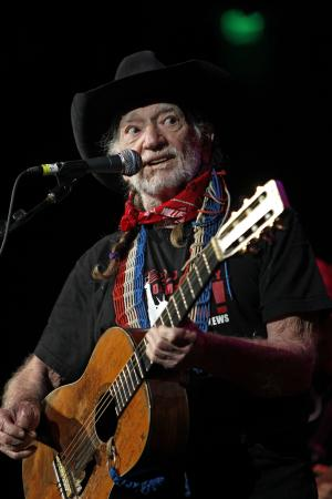 "FILE - This Oct. 17, 2011 file photo shows country singer Willie Nelson during ""Fire Relief, The Concert For Central Texas"" at the Frank Erwin Center in Austin, Texas. Nelson will be joined by Toby Keith, Zac Brown Band and Darius Rucker on Nelson's song ""Roll Me Up"" on Wednesday's, June 6, 2012, CMT Awards. (AP Photo/Erich Schlegel, file)"