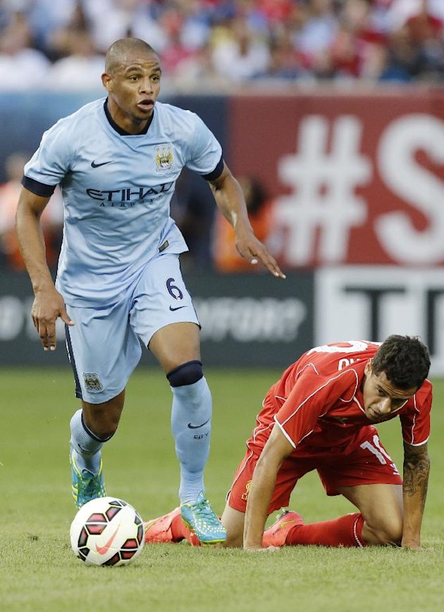 Manchester City's Fernando gains control of the ball as Liverpool's Philippe Coutinho (10) falls down in the first half of a Guinness International Champions Cup soccer tournament match  Wednesday, July 30, 2014, in New York. (AP Photo/Frank Franklin II)