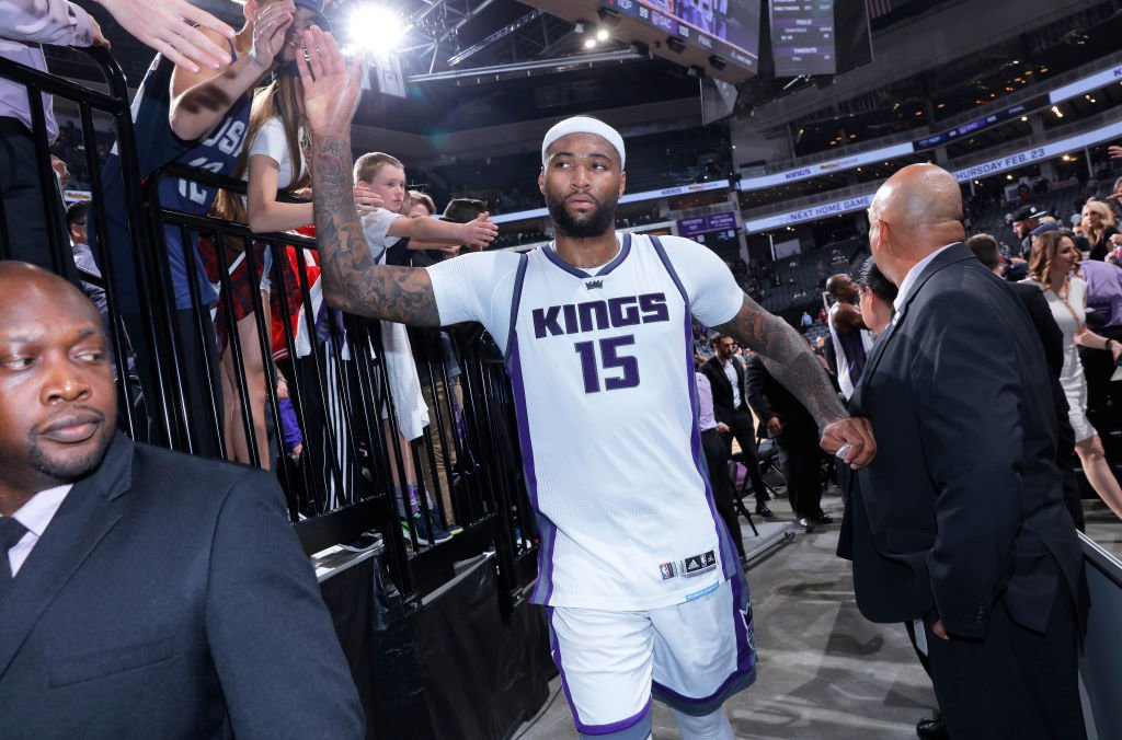 DeMarcus Cousins greets Kings fans after beating the Pelicans on Feb. 12, 2017 at Golden 1 Center in Sacramento. (Rocky Widner/NBAE/Getty Images)