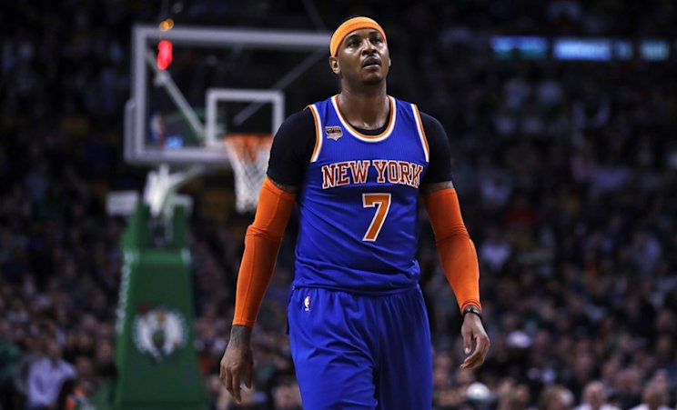 Carmelo Anthony has $54 million remaining over the next two years of his contract. (AP)