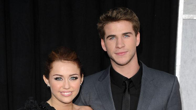 "Miley Cyrus and Liam Hemsworth arrive at the premiere of Touchstone Picture's ""The Last Song"" held at ArcLight Hollywood on March 25, 2010 in Los Angeles, California."