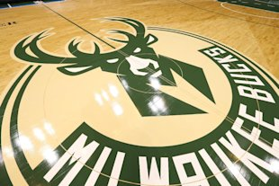 It looks like the Bucks' new logo will continue to occupy courts in Milwaukee for some time. (Gary Dineen/NBAE/Getty Images)
