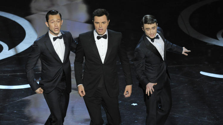 Actors, from left, Joseph Gordon-Levitt, host Seth MacFarlane and Daniel Radcliffe perform during the Oscars at the Dolby Theatre on Sunday Feb. 24, 2013, in Los Angeles.  (Photo by Chris Pizzello/Invision/AP)