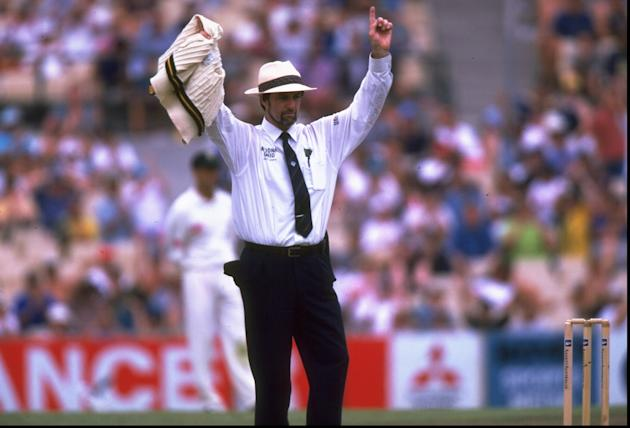 Umpire, Peter Willey of England signals six runs