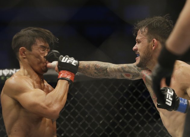 Alberto Mina, right, of Brazil lands a punch against Yoshihiro Akiyama of Japan during their Welterweight bout at the UFC Fight Night Seoul in Seoul, South Korea, Saturday, Nov. 28, 2015. Mina defeated Akiyama via split decision.(AP Photo/Ahn Young-joon)