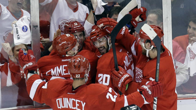 Detroit Red Wings right wing Patrick Eaves (17) celebrates his goal with teammates Cory Emmerton (25), Drew Miller (20), Kyle Quincey (27) and Brendan Smith, right, during the first period of Game 6 of the NHL hockey Stanley Cup playoffs Western Conference semifinals against the Chicago Blackhawks in Detroit, Monday, May 27, 2013. (AP Photo/Carlos Osorio)