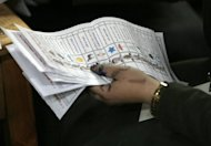 An Egyptian election official counts ballot papers at a polling station in Cairo, May 24. Vote counting was underway in Egypt Friday after two days of polling in a landmark presidential election which pitted stability against the ideals of the uprising that ended Hosni Mubarak's rule