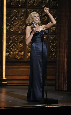 "Nina Arianda accepts the Tony for leading actress in a play for ""Venus in Fur,"" at the 66th Annual Tony Awards on Sunday June 10, 2012, in New York. (Photo by Charles Sykes /Invision/AP)"