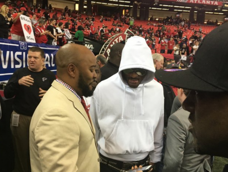 Future (in hoodie) on the Falcons sideline