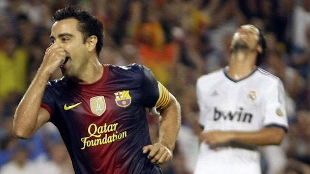 Barcelona's Xavi celebrates scoring against Real Madrid in their Spanish Super Cup first leg clash at Nou Camp (Reuters)