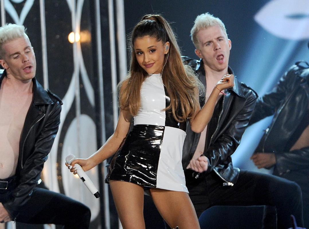 "FILE - In this May 18, 2014 file photo, Ariana Grande performs at the Billboard Music Awards at the MGM Grand Garden Arena, in Las Vegas. MTV will reprise its former ""Total Request Live"" countdown show for a day with breakthrough pop singer Ariana Grande. The network announced Wednesday, June 25, 2014, it will bring back the series on July 2. (Photo by Chris Pizzello/Invision/AP, file)"