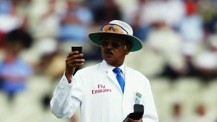 Umpire Venkat checks the light