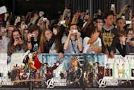 "Film fans take photographs during the Marvel Avengers Assemble European Premiere in London in April 2012. ""The Avengers"" kept packing its amazing box-office punch, industry data showed Sunday, breaking records and powering its way on the top at North American box offices for a third week"