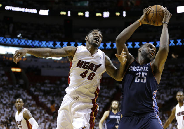 Charlotte Bobcats' Al Jefferson (25) takes a pass from a teammate over Miami Heat's Udonis Haslem (40) during the second half in Game 1 of an opening-round NBA basketball playoff series on Sun
