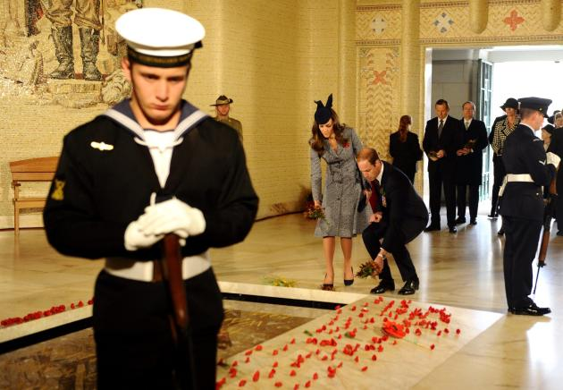 Britain's Prince William and his wife Catherine, Duchess of Cambridge, lay wreaths at the Tomb of the Unknown Soldier on ANZAC Day in Canberra