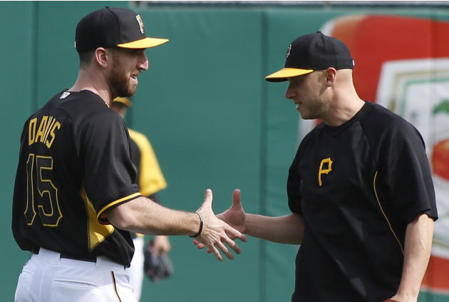 Pittsburgh Pirates first baseman Ike Davis, left, who was jacquired from the New York Mets in a trade the day before, shakes hands with shortstop Clint Barmes during batting practice before the Pirate