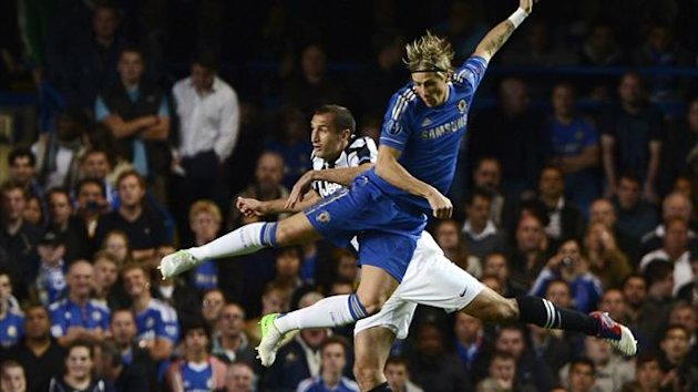 Chelsea's Fernando Torres (front) challenges Juventus' Giorgio Chiellini during their Champions League match at Stamford Bridge (Reuters)