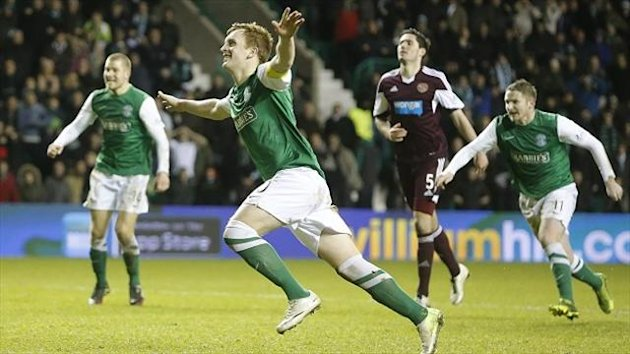 Liam Craig celebrates after scoring the match-winning penalty at Easter Road