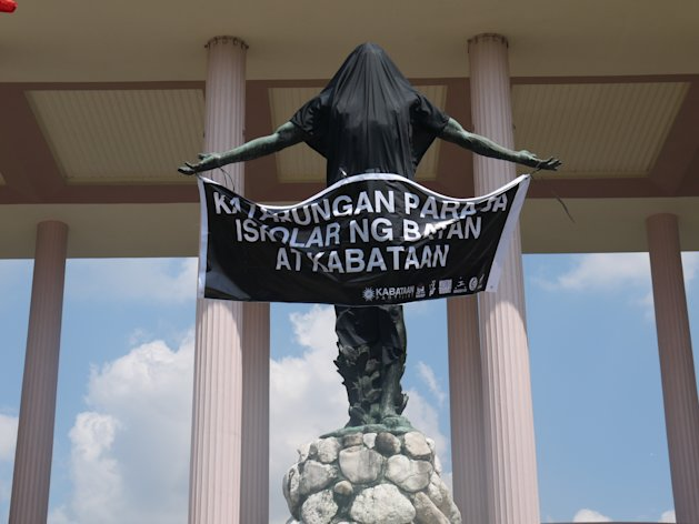 The famed oblation statue outside the premier state university's Quezon Hall was draped with a black cloth, following the suicide of a UP Manila student.