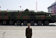 A North Korean soldier stands guard in front of a military vehicle carrying what is believed to be a Taepodong-class missile Intermediary Range Ballistic Missile (IRBM), on April 15. The White House warned North Korea to refrain from future hostile acts amid indications Pyongyang could soon embark on a new nuclear test or may plan future missile launches