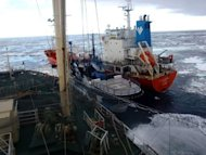 This picture taken by Japan's Institute of Cetacean Research (ICR) on February 20, 2013 shows the environmental group ship Sea Shepherd sandwiched between an oil supply ship (R) and Japan's whaling vessel Nisshin Maru (L) in the Southern Ocean. The conservationist group accused the Japanese side of deliberately colliding with its vessels