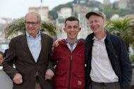 "(From left) British director Ken Loach, actor Paul Brannigan and British scriptwriter Paul Laverty pose during the photocall of ""The Angel's Share"" at the 65th Cannes Film Festival on May 22. Brannigan, the street-cast young star of Loach's new Glasgow-set comedy, told Cannes on Tuesday that the picture probably saved his life"