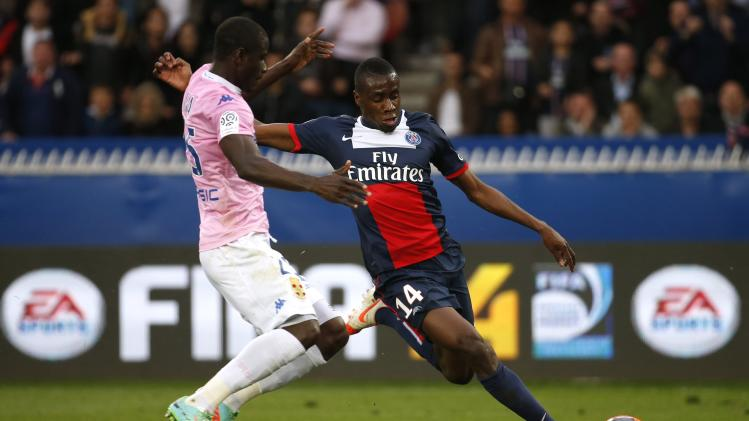 Paris St Germain's Matuidi scores a goal against Mensah of Evian Thonon Gaillard during their French Ligue 1 soccer match at the Parc des Princes Stadium in Paris