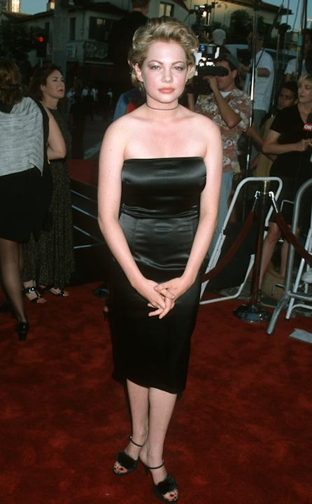 Michelle Williams in a black satin strapless dress