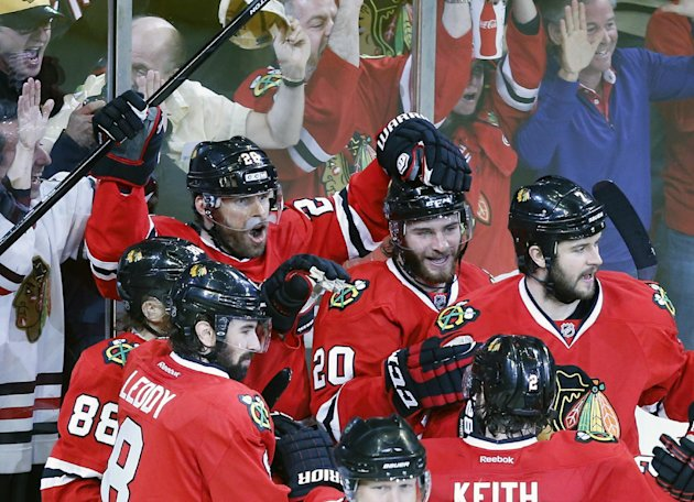 Chicago Blackhawks center Michal Handzus (26) celebrates a game winning goal with his teammates during the second overtime period in Game 5 of the Wes...