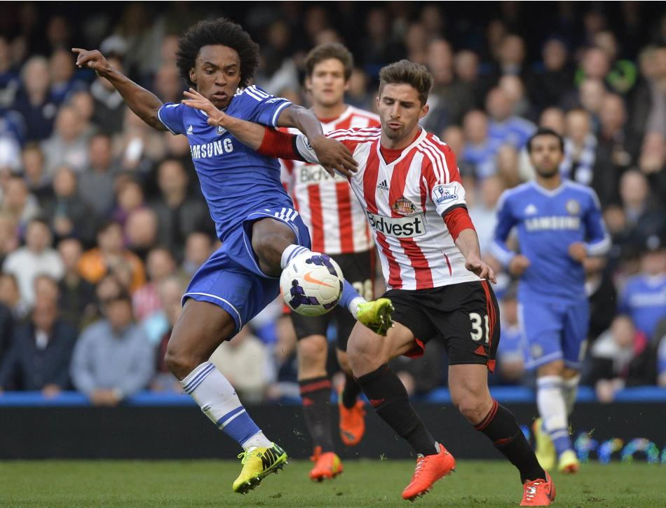 Chelsea's Willian challenges Sunderland's Borini during their English Premier League soccer match in London