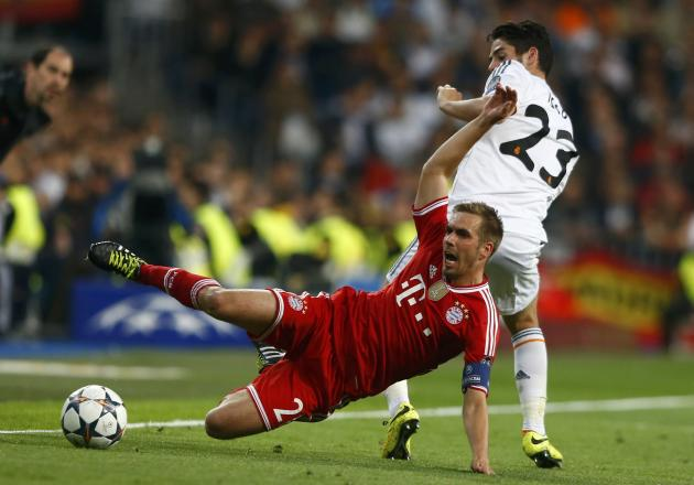 Bayern Munich's Lahm is fouled by Real Madrid's Isco during Champion's League semi-final first leg soccer match in Madrid
