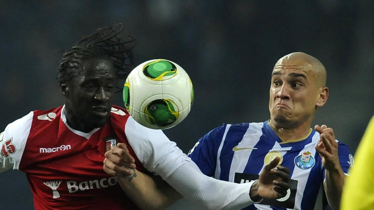 FC Porto's Maicon Roque, right, from Brazil vies with Sporting Braga's Eder Lopes, from Guinea-Bissau, in a Portuguese League soccer match at the Dragao Stadium in Porto, Portugal, Saturday, Dec. 7, 2013. Porto won 2-0