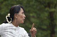 Myanmar democracy icon Aung San Suu Kyi waves to refugees during her visit to the Mae La refugee camp near the Thai-Myanmar border on June 2. She will visit France from June 26 to 29 at the invitation of new President Francois Hollande