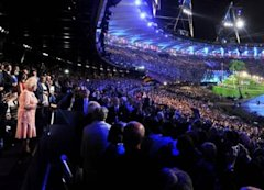 Queen Elizabeth II, left, makes a speech at the Opening Ceremony for the 2012 Summer Olympic Games, Friday, July 27, 2012, in London. (AP Photo/John S