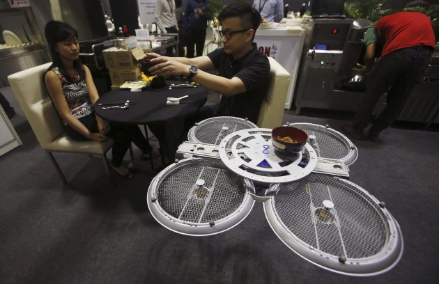 Visitors are served by an Infinium-Serve UAV, designed to serve food and wait tables (Reuters)