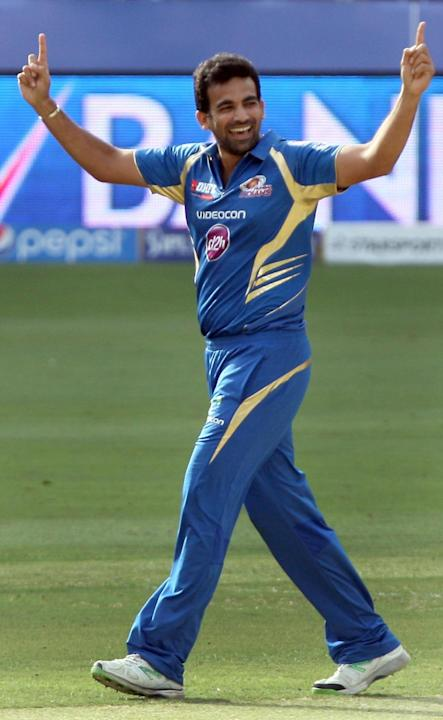 MI bowler Zaheer Khan celebrates fall of a wicket during the fifth match of IPL 2014 between Royal Challengers Bangalore and Mumbai Indians, played at Dubai International Cricket Stadium in Dubai of U