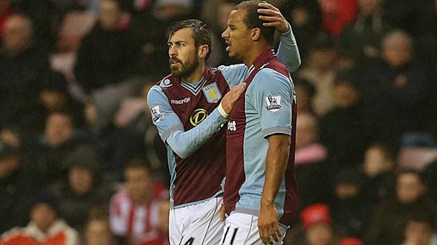 Aston Villas English striker Gabriel Agbonlahor (R) is congratulated by Aston Villa's Spanish defender Antonio Luna (PA)