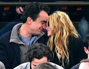 Mary-Kate Olsen, 26, Nuzzles Olivier Sarkozy, 42, at Basketball Game