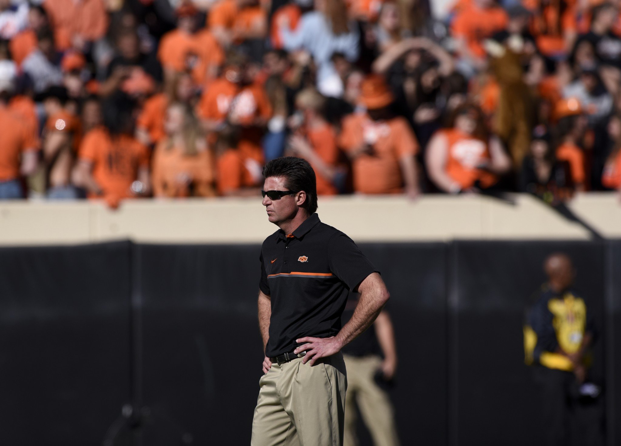 Oklahoma State head coach Mike Gundy watches his team prractice before the start of an NCAA college football game with Texas Tech in Stillwater, Okla., Saturday, Nov. 12, 2016.(AP Photo/Brody Schmidt)