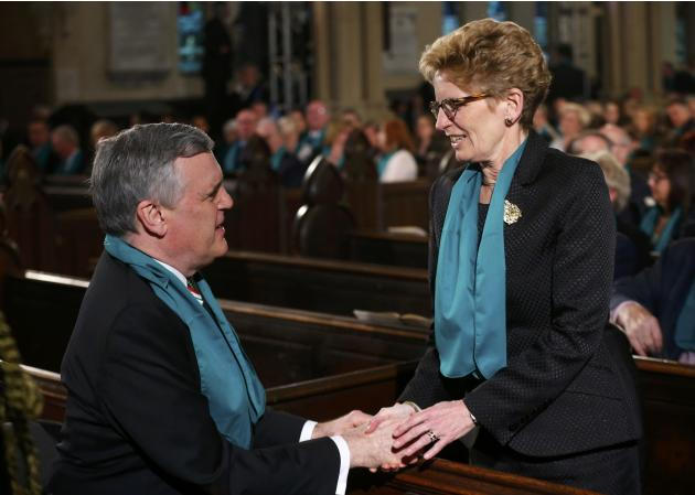 Ontario Premier Kathleen Wynne shakes hands with Ontario's Lieutenant Governor David Onley before the state funeral for Canada's former finance minister Jim Flaherty in Toronto