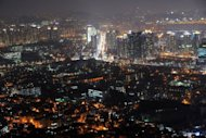 The skyline of Seoul at night. South Korea must act to curb household debts totalling hundreds of billions of dollars that pose a downside risk to the economy, the top financial watchdog said Wednesday