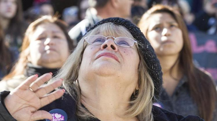 Fans mourn Jenni Rivera at a memorial televised a on giant television in Universal City in Los Angeles Wednesday, Dec. 19, 2012. The 43-year-old Rivera and six others died Dec. 9 in a crash that remained under investigation. Rivera sold more than 15 million copies of her 12 major-label albums. Her soulful singing style and honesty about her tumultuous personal life won her fans on both sides of the U.S.-Mexico border. She was also an actress and reality-TV star.  (AP Photo/Damian Dovarganes