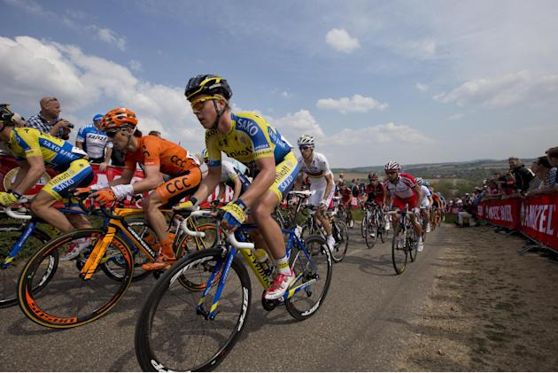 Denmark's Michael Valgren Andersen, center in bleu and yellow, Poland's Maciej  Paterski, second left in orange, and Spain's Rui Alberto Costa, rear in white, climb Gulpenerberg during the