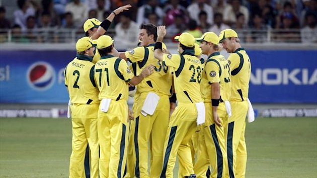 Australia's Patrick Cummins (C) celebrates with his teammates the wicket of Pakistan's Mohammad Hafeez during their third Twenty20 international cricket match in Dubai (Reuters)