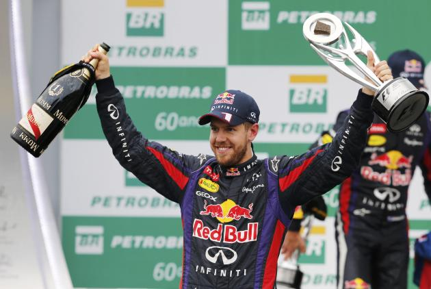 Sebastian Vettel of Germany celebrates with the trophy on the podium after the Brazilian F1 Grand Prix at the Interlagos circuit in Sao Paulo