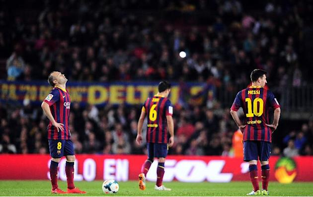 FC Barcelona's Andres Iniesta, left, Xavi Hernandez, center, and Lionel Messi, from Argentina react after Athletic Bilbao scored during a Spanish La Liga soccer match at the Camp Nou stadium in Ba